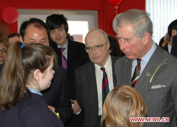 Charles (1st R), Prince of Wales, and Chinese Ambassador to the United Kingdom Liu Xiaoming attend the opening of the Confucius Classroom at the Llandovery College in Wales, Britain, March 1, 2011. The Llandovery College saw on Tuesday the launching of Wales' first Confucius Classroom, a non-profit program aiming at teaching Chinese language and culture.