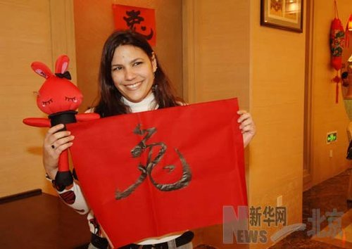 A student from Cuban shows her Chinese calligraphy in Chinese New Year Celebration Party held in the Beijing Language and Culture University on February 1. The number of foreign students in China has risen dramatically, hitting a record high of more than 260,000 in 2010, according to statistics released by the Ministry of Education.