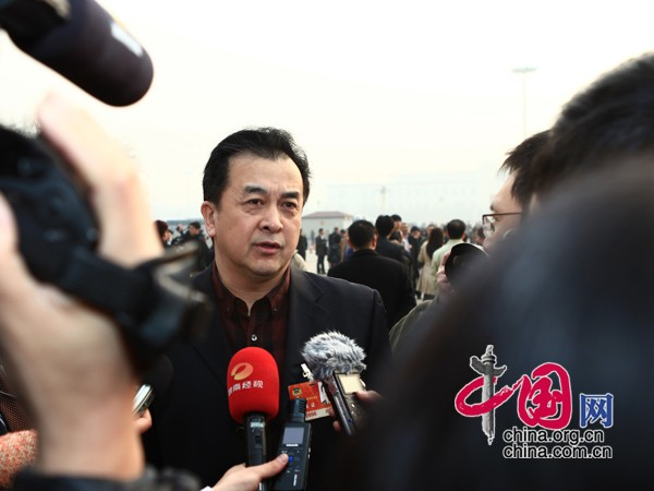 Huang Hong, a member of the Chinese People's Political Consultative Conference (CPPCC) to attend the closing meeting of the Fourth Session of the 11th CPPCC National Committee at the Great Hall of the People in Beijing, capital of China, March 13, 2011.
