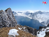 Tianchi Lake or Heaven Lake is a crater lake perched atop the Changbai Mountains in northeast China's Jilin Province. It is believed to be a holy lake by the locals and its scenery varies greatly as the season changes. [Courtesy of Changbai Mountain Tourist Administration]
