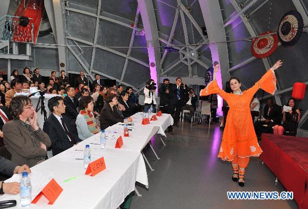 A contestant performs Chinese traditional folk dance during the final of the 10th 'Chinese Bridge' Chinese Proficiency Competition for Foreign College Students in Belgium, in Brussels, Belgium, March 26, 2011. The 10th 'Chinese Bridge' Chinese Proficiency Competition for Foreign College Students in Belgium concluded here Saturday.