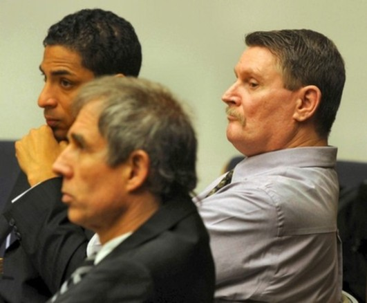 Herbert Mike Merritt, right, listens as the state begins their closing arguments Tuesday, March. 29, 2011. Merritt is charged with the June 2008 first-degree murder of Anthony Laymond 'Tony' Ford, at the Friends Sports Bar and Grill. At left are defense attorneys Phil Lomonaco, bottom and John Young, top.