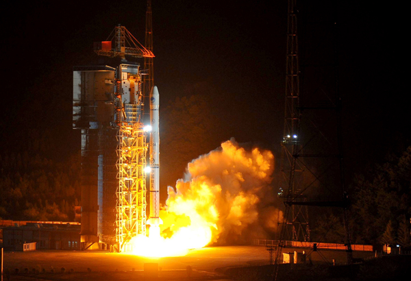 A Long March-3A carrier rocket lifts off at the Xichang Satellite Launch Center in southwest China's Sichuan Province, Apr. 10, 2011. China successfully launched into space a eighth orbiter for its independent satellite navigation and positioning network known as Beidou, or Compass System Saturday. [Xinhua photo]