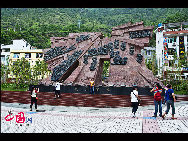 Luding Bridge is located in Ganzi Zang Autonomous Prefecture of Sichuan Province. It was originally built in 1705 during the Reign of Emperor Kangxi in Qing Dynasty, and completed in 1706. It became famous after the Long March. [China.org.cn]