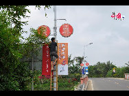 Posters advertising new real estate developments.[Wang Zhiyong/China.org.cn]
