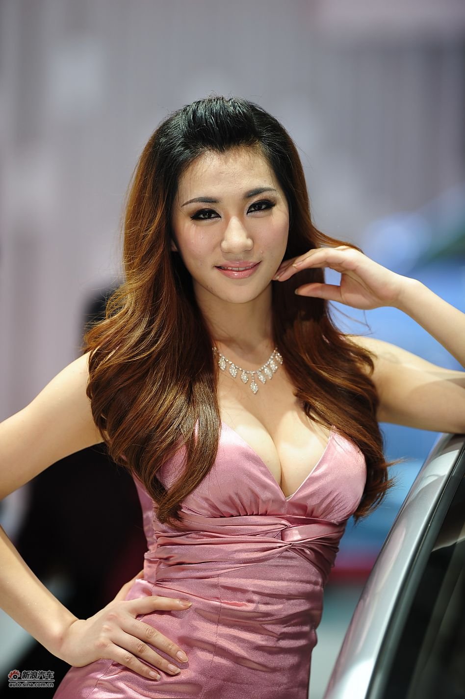 Model poses for Changan PSA at Auto Shanghai 2011, the 14th Shanghai International Automobile Industry Exhibition, which opens in the city's new International Expo Center from April 19-28. [Sina]