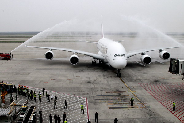 An Airbus A380 plane taxies on tarmac after touchdown at the Pudong International Airport in east China's Shanghai, April 27, 2011. The Emirates Flight EK302 is the first regular A380 air service to Shanghai. As the largest passenger plane in the world, the Airbus A380 seats up to 853 people at a cruising speed of up to 900 km/h or 560 mph.