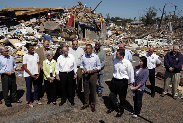 U.S. President Barack Obama speaks while he tours damage caused by devastating severe storms and tornadoes in the Tuscaloosa, Alabama, area, April 29, 2011. [Xinhua/Reuters Photo]