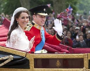 Britain's Prince William and his bride Kate Middleton wave on their way to Buckingham Palace after their wedding at Westminster Abbey in London, April, 29, 2011. [Tang Shi/Xinhua]