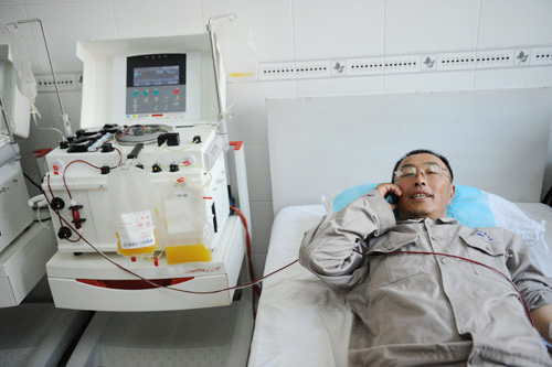 Guo Mingyi has donated 60 liters of blood over the past two decades.