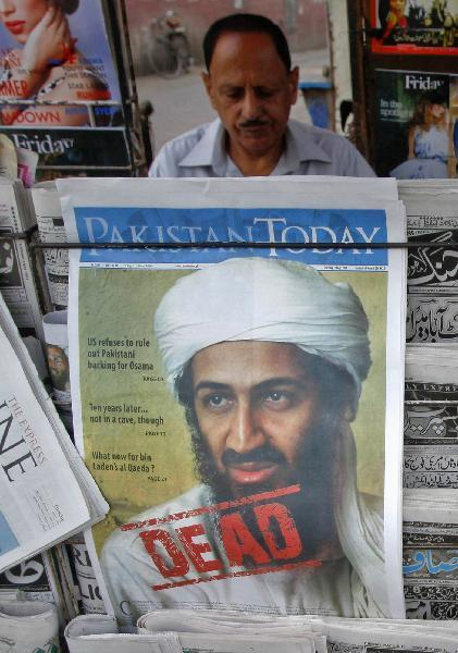 Photo taken on May 3 shows bin Laden's portrait on the frontpage of a piece of newspaer sold in Lahore, Pakistan. Al-Qaida has confirmed its leader Osama bin Laden's death, reported local English TV channel Express on Friday afternoon. [Xinhua/Reuters]