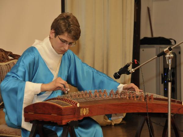 A contestant plays the Chinese zither during the final of the 10th 'Chinese Bridge' Chinese Proficiency Competition for Foreign College Students in Moscow, capital of Russia, on May 6, 2011. The 10th 'Chinese Bridge' Chinese Proficiency Competition for Foreign College Students in Moscow concluded here Friday. [Zhao Danwen/Xinhua]