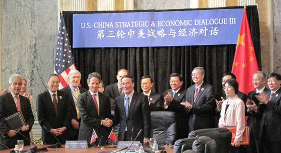 US Treasury Secretary Tim Geithner (4th L) and Chinese Vice-Premier Wang Qishan shake hands after participating in a signing ceremony for a 'US-China Comprehensive Framework for Promoting Strong, Sustainable and Balanced Growth and Economic Cooperation', during the US-China Strategic and Economic Dialogue at the Treasury Department in Washington May 10, 2011. [Xinhua]