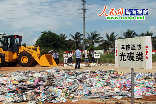 South China's Haikou police publicly destroy pirated audio and video products on May 15, 2011. Chinese police have raided nearly 7,530 dens as of April, since the Ministry of Public Security launched a campaign to halt the production and sale of counterfeit goods last November