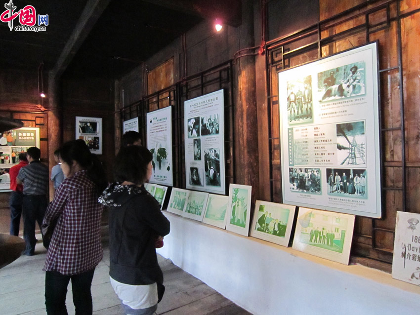 An exhibit inside Dengchigou Church displays photos and stories of how David discovered the giant pandas and introduced them to the West. [Wang Qian/China.org.cn]