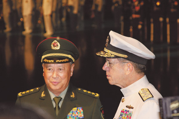 General Chen Bingde, Chief of the General Staff of the People's Liberation Army, meets with Admiral Michael Mullen, chairman of the US Joint Chiefs of Staff , in Washington after an armed forces full honor review ceremony on Tuesday to mark Chen's visit to the US. [China Daily]