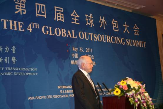 Former prime minister of Australia John Howard addresses a crowd of international political and business leaders at the opening ceremony for the 4th Global Outsourcing Summit on May 23, 2011 in Ma'anshan, Anhui Province.