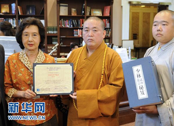 Shaolin Temple, the ancient Chinese monastery famed for its Buddhist traditions and kongfu, on Wednesday donated books about the temple's kongfu and medicine to the Library of Congress in Washington. Arch Abbot Shi Yongxin (M) from the Shaolin Temple participated in the ceremony held at the library.