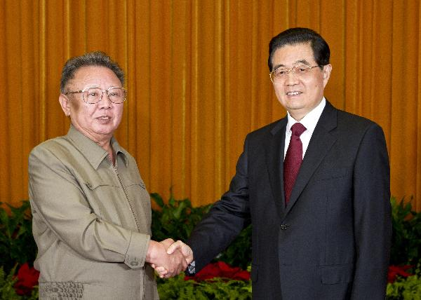 Chinese President Hu Jintao (R) shakes hands with Kim Jong Il, general secretary of the Workers' Party of Korea (WPK) and chairman of the National Defense Commission of the Democratic People's Republic of Korea (DPRK), during their talks in Beijing, capital of China, May 25, 2011. [Li Xueren/Xinhua]