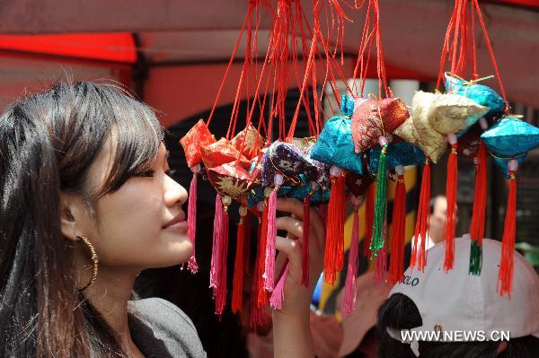 A girl views fragrant bags at the traditional rice food festival held in Taipei, south China's Taiwan, May 29, 2011. A traditional rice food festival kicked off in Taipei on Sunday, attracting many citizens to taste delicious snacks.