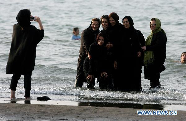 iranin man woman beach