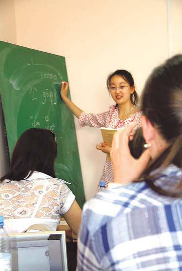 A Chinese volunteer teaches Mandarin at the Confucius Institute at the L.N. Gumilyov Eurasian National University in Astana, Kazakhstan, on Tuesday.