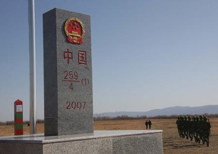 Chinese soldiers begin border patrol near the newly unveiled boundary marker for eastern section of China-Russia border at Heixiazi Island, October 14, 2008.