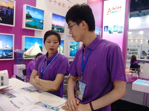 Global picture—Workers at Beijing Global Tour International Travel Service Co., Ltd, wait for potential customers to visit.