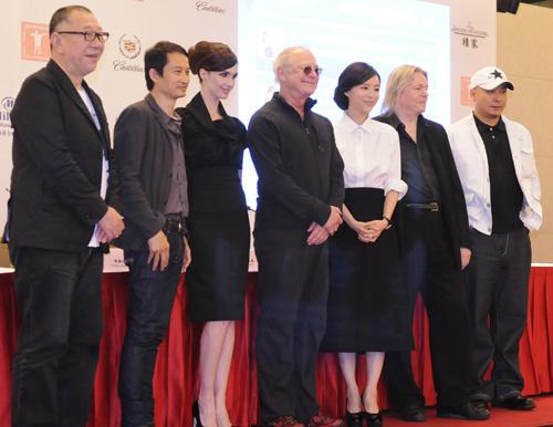 All the jury members of the 14th Shanghai International Film Festival meet the press in Shanghai on June 11, 2011.