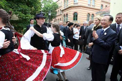Chinese Premier Wen Jiabao (R front) watches a folk dancing performed by students at the Eotvos Lorand University in Budapest, Hungary, June 24, 2011. [Xinhua/Yao Dawei]