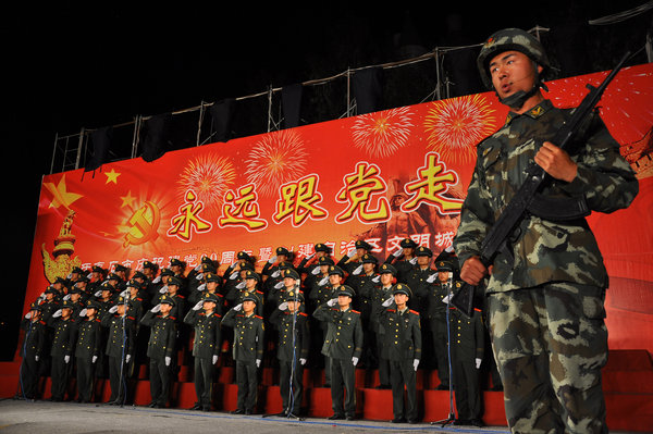 The army performs on stage during a songfest to celebrate the 90th anniversary of the founding of the Communist Party of China (CPC) in north China's Inner Mongolia on June 27.