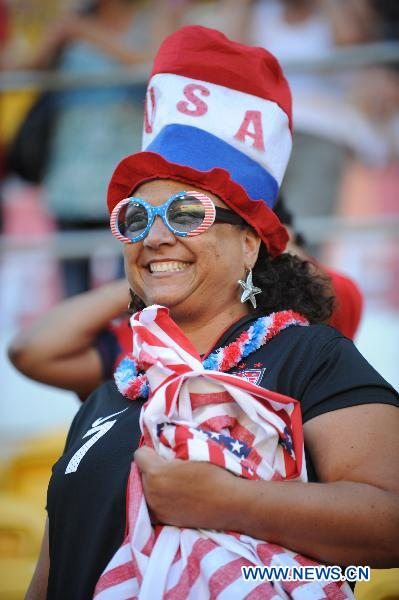 A fan of the U.S. reacts before the Group C first round match between the United States and the Democratic People's Republic of Korea (DPRK) at the 2011 FIFA Women's World Cup at the Rudolf-Harbig-Stadion in Dresden, Germany, June 28, 2011. (Xinhua/Li Jundong)