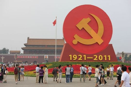 An emblem of the Communist Party of China (CPC) is seen surrounded by flowers on the Tiananmen Square in Beijing, capital of China, June 30, 2011. The emblem and flowers were set up to celebrate the 90th anniversary of the founding of the CPC.