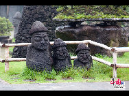 Stone figures made of local volcanic rock. These figures will bless people to prosper and multiply, locals say. [François Chen / China.org.cn]