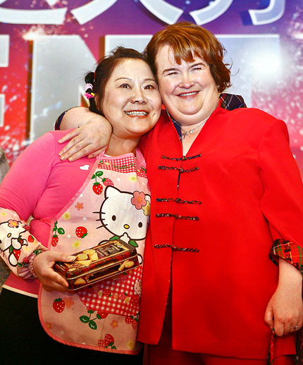 Scottish singing sensation Susan Boyle poses with Cai Hongping, better known by her nickname Auntie Sweetie, at a press conference in Shanghai yesterday for the final of the second season of 'China's Got Talent.'
