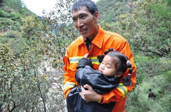 A rain-triggered landslide blocked Yajiang section of National Highway 318 and stranded four people Wednesday morning, who were rescued around noon. No casualties had been reported. 