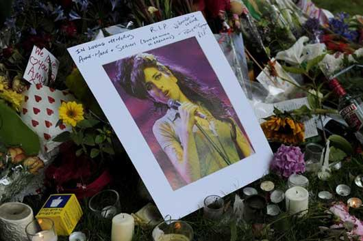 Flowers, pictures and messages are left in tribute to late soul music and pop star Amy Winehouse, near the house in north London where her body was found the previous day, on July 24, 2011.