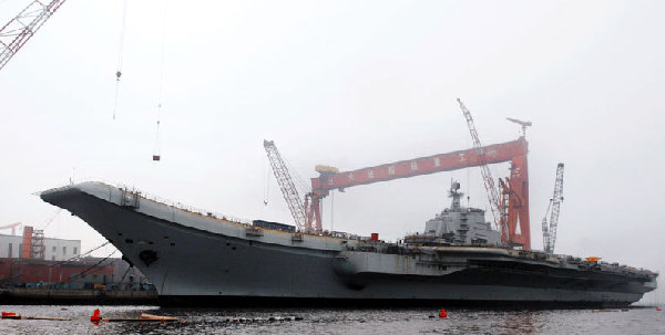 China refitting aircraft carrier for research, training