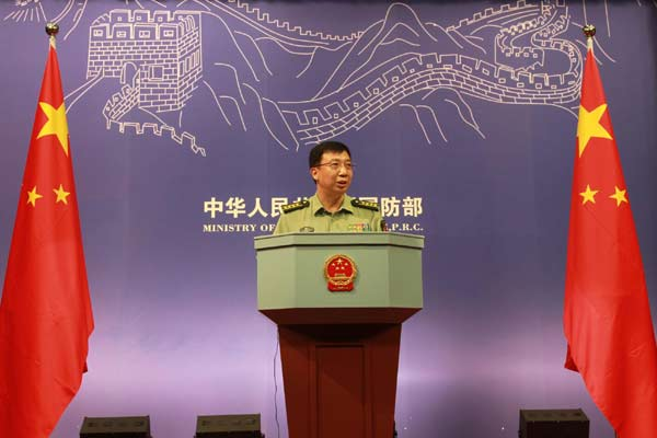 Defense Ministry spokesman Geng Yansheng answers questions during a news conference in Beijing, July 27, 2011.[Xinhua]