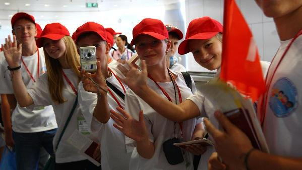 Russian teenagers arrive at the Beijing Capital International Airport in Beijing, capital of China, July 30, 2011. At the invitation of Chinese President Hu Jintao, 450 Russian elementary and secondary school students arrived in China on Saturday, embarking on a 12-day summer camp in China.