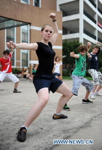 German students practice Chinese Kung Fu in the NO. 168 High School in Hefei, central China's Anhui Province, Aug. 9, 2011.