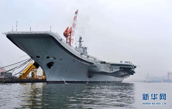 File photo of China's refitted aircraft carrier. The aircraft carrier left its shipyard at Dalian Port in northeast Liaoning Province on Wednesday morning to start its first sea trial. Military sources said that the first sea trial was in line with schedual of the carrier's refitting project and would not take a long time. After returning from the sea trial, the aircraft carrier will continue refit and test work.