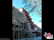 Carved out of the cliffs 25 km southeast of Dunhuang, Gansu province, Mogao Grottoes lay at a strategic point on the ancient Silk Road, where religion, culture and commerce between East and West intersected for 1,000 years from the 4th century until the Yuan Dynasty (1271-1368).There are 492 caves, 2,415 sculptures and 45,000 sq m of murals at the site, which spans 1,600 m from north to south.[China.org.cn]