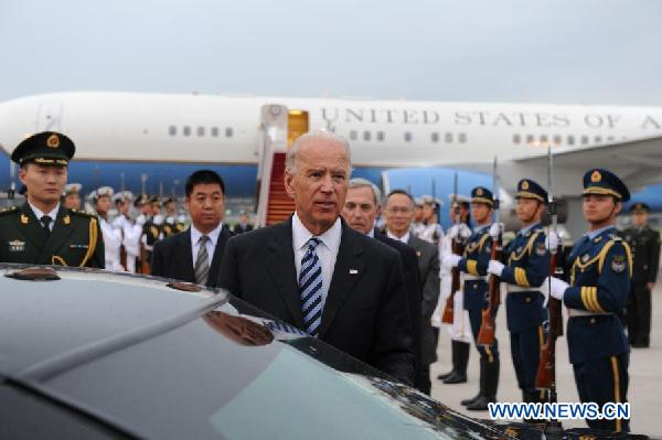 The Vice President of the United States Joseph Biden (front) arrives in Beijing, capital of China, on Aug. 17, 2011. [Li Xueren/Xinhua]