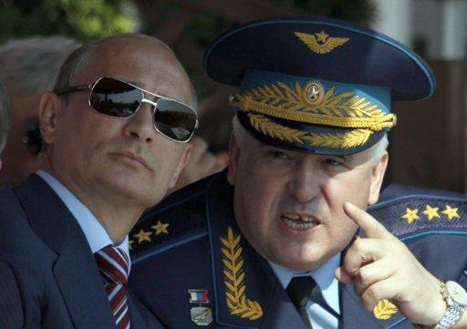 Russian Prime Minister Vladimir Putin (L) and Commander-in-Chief of the Russian Air Force Alexander Zelin watch a display during the opening of the MAKS International Aviation and Space Salon at Zhukovsky airport outside Moscow August 17, 2011.