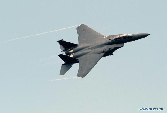 An F-15E performs on the Tenth Russia International Aerospace Exhibition in Moscow, Russia on Aug. 16, 2011. The Exhibition will last for six days, with the participation of 793 companies from 40 nations and regions.