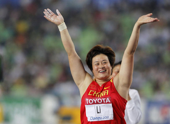 Li Yanfeng wins China's first world title in discus throw