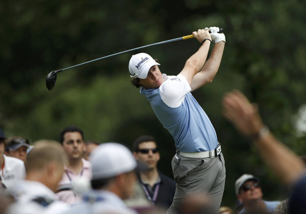 Northern Ireland's Rory McIlroy hits from the fourth tee during the third round of the 2011 U.S. Open golf tournament at Congressional Country Club in Bethesda, Maryland, June 18, 2011. (Xinhua/Reuters Photo) 