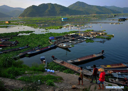 Photo taken on Sept. 3, 2011 shows a aquaculture base at Shuikou Township section of the Minjiang River in Gutian County in southeast China's Fujian Province.