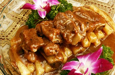 Pork ribs with fried New year cake, one of the 'top 10 most famous Shanghai snacks' by China.org.cn.